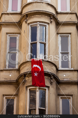 Turkish Flag Hung from Istanbul Window stock photo, Turkish Flag Hung from Istanbul Apartment Window by Scott Griessel