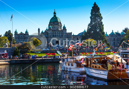 Provincial Capital Legislative Buildiing Wooden Boats Inner Harb stock photo, VICTORIA, BRITISH COLUMBIA - AUGUST 31, 2013 Provincial Capital Legislative Parliament Buildiing and Wooden Boats in Inner Harbor British Columbia Canada on August 31, 2013 by William Perry