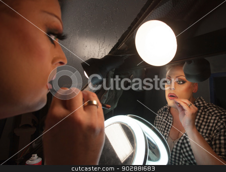 Reflection of Man with Lipstick Pencil stock photo, Man with reflection in mirror putting on lipstick by Scott Griessel
