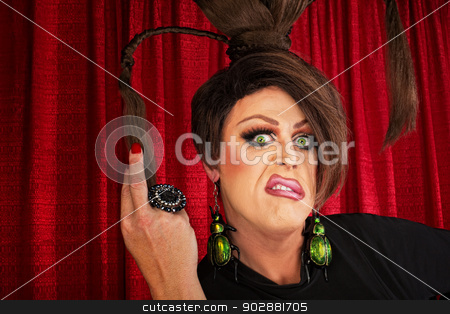 Annoyed Drag Queen stock photo, Annoyed European drag queen pulling on ponytails by Scott Griessel