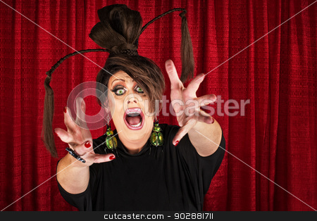 Drag Queen Reaching Out stock photo, Frantic Caucasian drag queen in theater reaching out by Scott Griessel