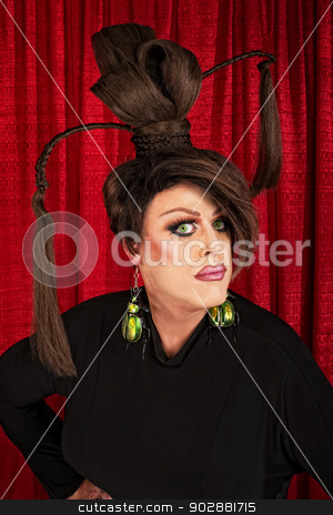 Serious Drag Queen in Black stock photo, Serious man in ponytails and large beetle earrings by Scott Griessel