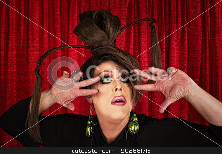 Eccentric Drag Queen Looking Up stock photo, Eccentric drag queen looking up with fingers near face by Scott Griessel