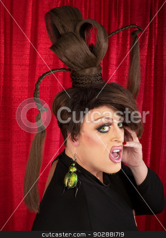 Surprised Man with Large Earrings stock photo, Surprised man in drag with ponytails and large earrings by Scott Griessel