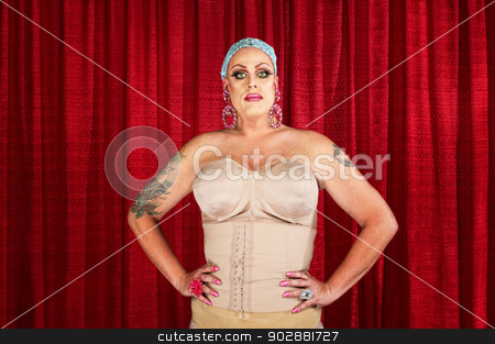 Drag Queen in Undergarments stock photo, Man in corset with tattoos on arms by Scott Griessel
