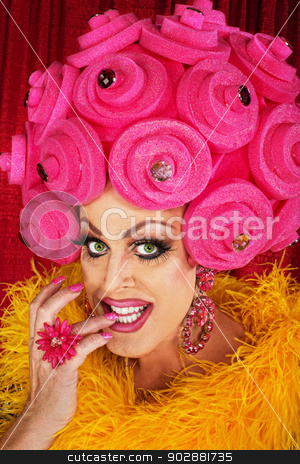 Grinning Drag Queen Biting Fingernails stock photo, Grinning drag queen in plastic wig biting fingernails by Scott Griessel