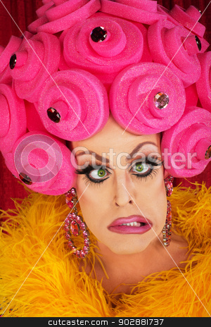 Frustrated Man in Drag stock photo, Cross eyed man in drag with plastic foam wig by Scott Griessel
