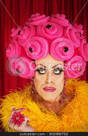 Thinking Drag Queen stock photo, Serious man in drag with yellow boa and wig by Scott Griessel