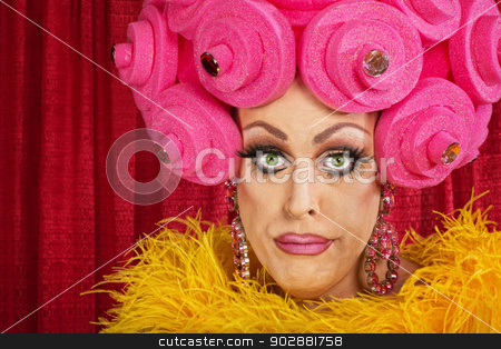 Doubting Drag Queen stock photo, Doubting drag queen with wig frowning in theater by Scott Griessel