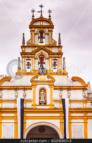 Basilica de la Macarena Bell Tower Bronze Bells Catholic Church  stock photo, Basilica de la Macarena Bell Tower with Bronze Bells and Weather Vanes Seville, Andalusia Spain.  Built in the 1700s. Houses the statue of the Macarena, the Virgin Mary with tears. by William Perry