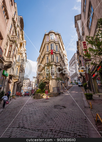 Busy Istanbul Neighborhood stock photo, ISTANBUL, TURKEY – APRIL 27: Building with flag and pedestrians on April 27, 2012 in Istanbul, Turkey.  Each year patriotic Turks honor those fallen at the battle of Galipoli during World War I. by Scott Griessel