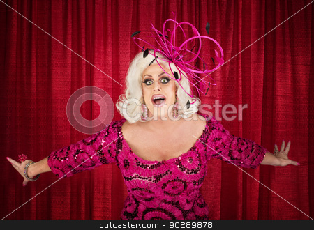 Blond Drag Queen Singing stock photo, Happy drag queen in blond with singing in theater by Scott Griessel