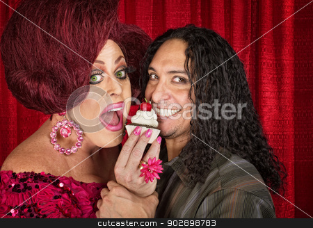 Smiling Couple with Cupcake stock photo, Drag queen with close friend eating cupcakes by Scott Griessel