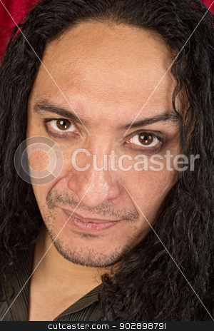 Attractive Unshaven Man stock photo, Close up of unshaven serious man with long hair by Scott Griessel