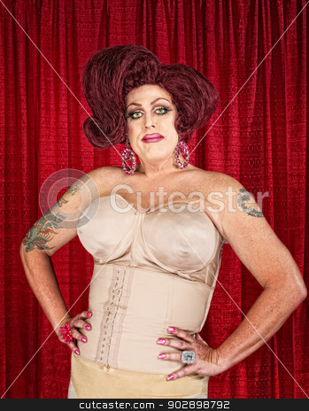 Drag Queen in Girdle stock photo, Big confident drag queen in girdle with hands on hips by Scott Griessel