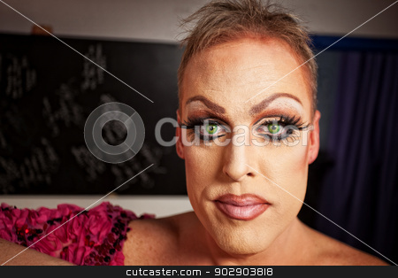 Close up of Man in Makeup stock photo, Serious man with makeup in backstage room by Scott Griessel