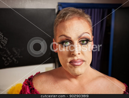 Drag Queen in Dressing Room stock photo, Close up of man with makeup in backstage room by Scott Griessel