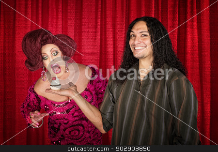 Man with Hungry Drag Queen stock photo, Smiling latino man with hungry drag queen and cupcake by Scott Griessel