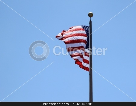 USA Flag stock photo, And old USA flag with a blue sky in the background. by Henrik Lehnerer