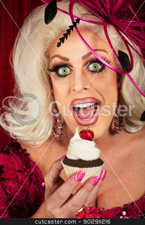 Happy Woman with Cupcake stock photo, Happy blond female singer eating a cupcake by Scott Griessel