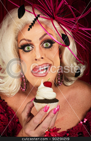Woman with Cupcake Licking Lips stock photo, Hungry female blond performer holding chocolate cupcake by Scott Griessel