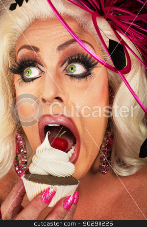 Blond Woman Snacking stock photo, Close up of blond actress eating chocolate cupcake by Scott Griessel