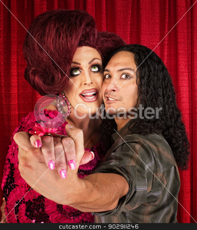 Retro Drag Queen with Dancing Partner stock photo, Man in 1960's retro hairdo dancing with partner by Scott Griessel