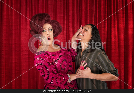 Cringing Transvestite and Kissing Man stock photo, Embarrassed drag queen pushing away kissing man by Scott Griessel