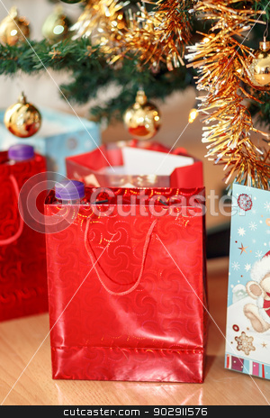 detail of gifts under decorated christmas tree stock photo, detail of gift boxes under decorated christmas tree by Artush