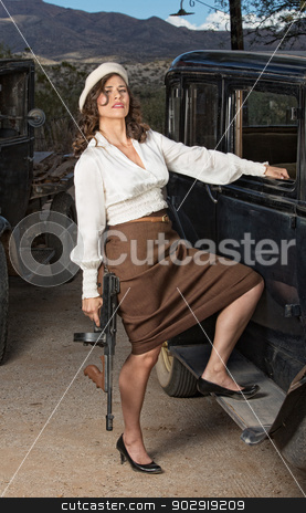 Beautiful 1920 Gangster Woman stock photo, Beautiful 1920s gangster woman with gun next to car by Scott Griessel
