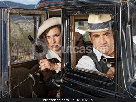 Serious Gangsters in Car stock photo, Serious retro gangsters in car with machine guns by Scott Griessel