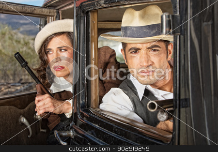 1920s Lookout Gangsters stock photo, Gangster couple on lookout in their antique automobile by Scott Griessel