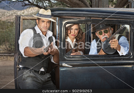 1920s Gangsters Aiming Weapons stock photo, Three 1920s gangsters aiming their weapons from a car window by Scott Griessel