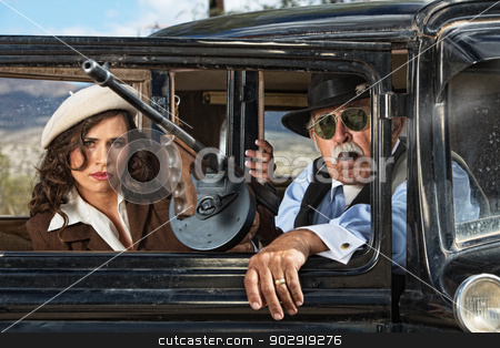 Gangsters with Machine Gun stock photo, Pair of 1920s vintage gangsters waiting inside an antique car by Scott Griessel