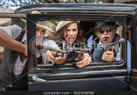 Gangsters Shooting From Car stock photo, Vintage gangsters shooting machine guns from car door by Scott Griessel