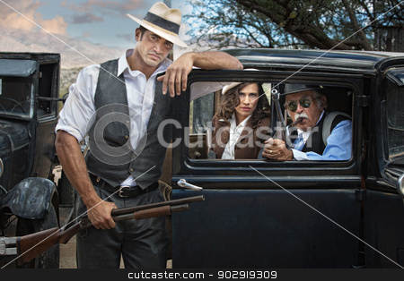 1920s Era Gangsters with Woman stock photo, Handsome 1920 era gangsters with pretty woman by Scott Griessel