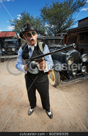 Gangster with Machine Gun Outdoors stock photo, Male gangster with sunglasses, cigar and machine gun outdoors by Scott Griessel