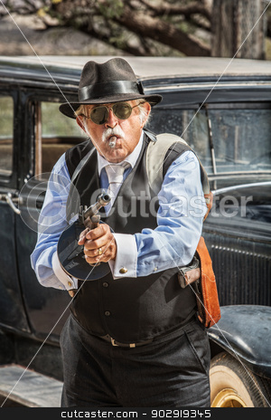 Male Gangster Aiming Machine Gun stock photo, Dangerous male gangster with cigar firing machine gun by Scott Griessel