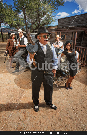 Tough Gangster with Friends stock photo, Tough middle aged criminal with gang outside by Scott Griessel