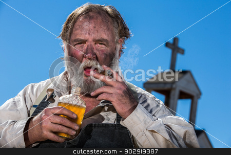 Old West Drunk stock photo, Old West Drunk Drinks Flask by Scott Griessel