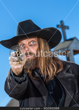 Man Holds Gun stock photo, A Bandit Points Gun At Camera by Scott Griessel