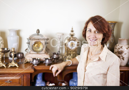 Woman with antique collection stock photo, Happy proud woman standing next to her collection of antiques by Elena Elisseeva