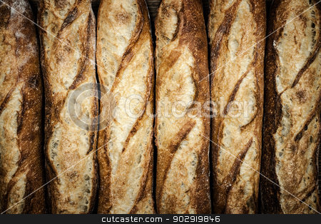 Baguettes stock photo, Fresh artisan baguette bread loaves in a row by Elena Elisseeva