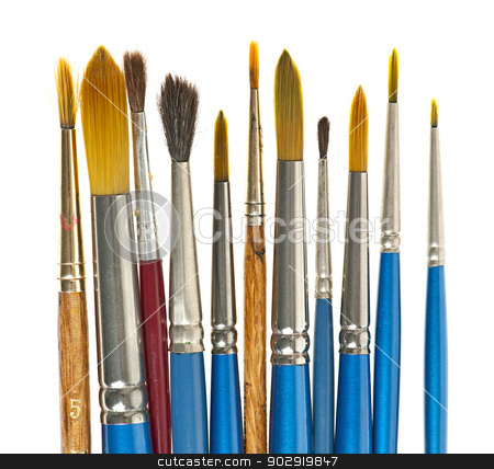 Paintbrushes on white stock photo, Various sizes of paintbrushes on white background by Elena Elisseeva