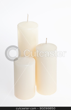 Candles on white stock photo, Three new white candles of various height by Elena Elisseeva
