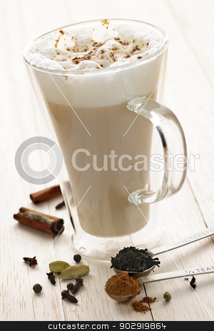 Chai Latte drink stock photo, Chai latte spiced tea beverage in glass mug with spices by Elena Elisseeva