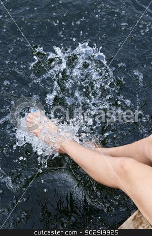 Legs splashing in lake stock photo, Girl sitting on dock splashing bare legs in lake by Elena Elisseeva