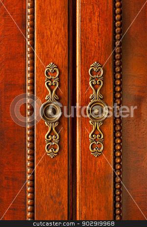 Door handles on cabinet stock photo, Ornate handles on wooden cabinet doors closeup by Elena Elisseeva