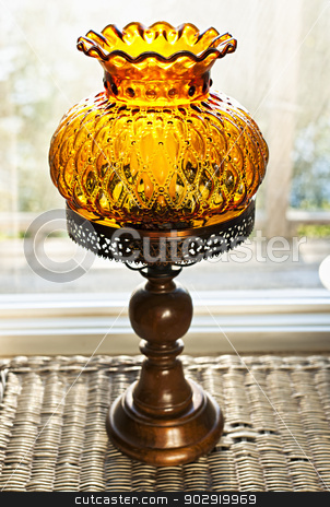 Antique lamp stock photo, Ornate antique amber glass and wood lamp by Elena Elisseeva