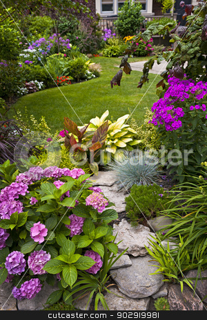 Garden and flowers stock photo, Lush landscaped garden with flowerbed and colorful plants by Elena Elisseeva
